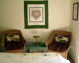 Treatment room: hanging quilt and a calming atmosphere